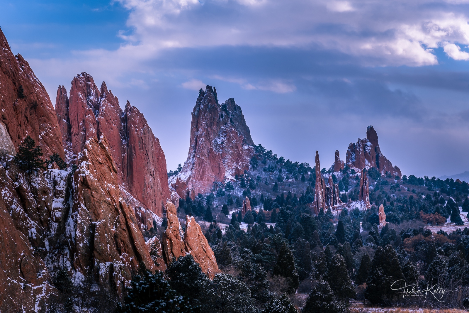 Piercing the sky of its surrounding landscape, the red, pink and white sandstone rock formations were created by intense forces...