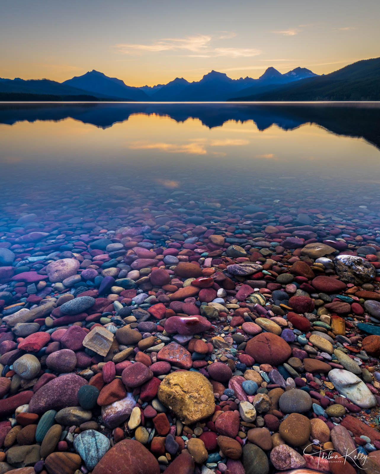 A Limited Edition of 50 A kaleidoscope of colorful rocks adorn the Lake McDonald's shoreline