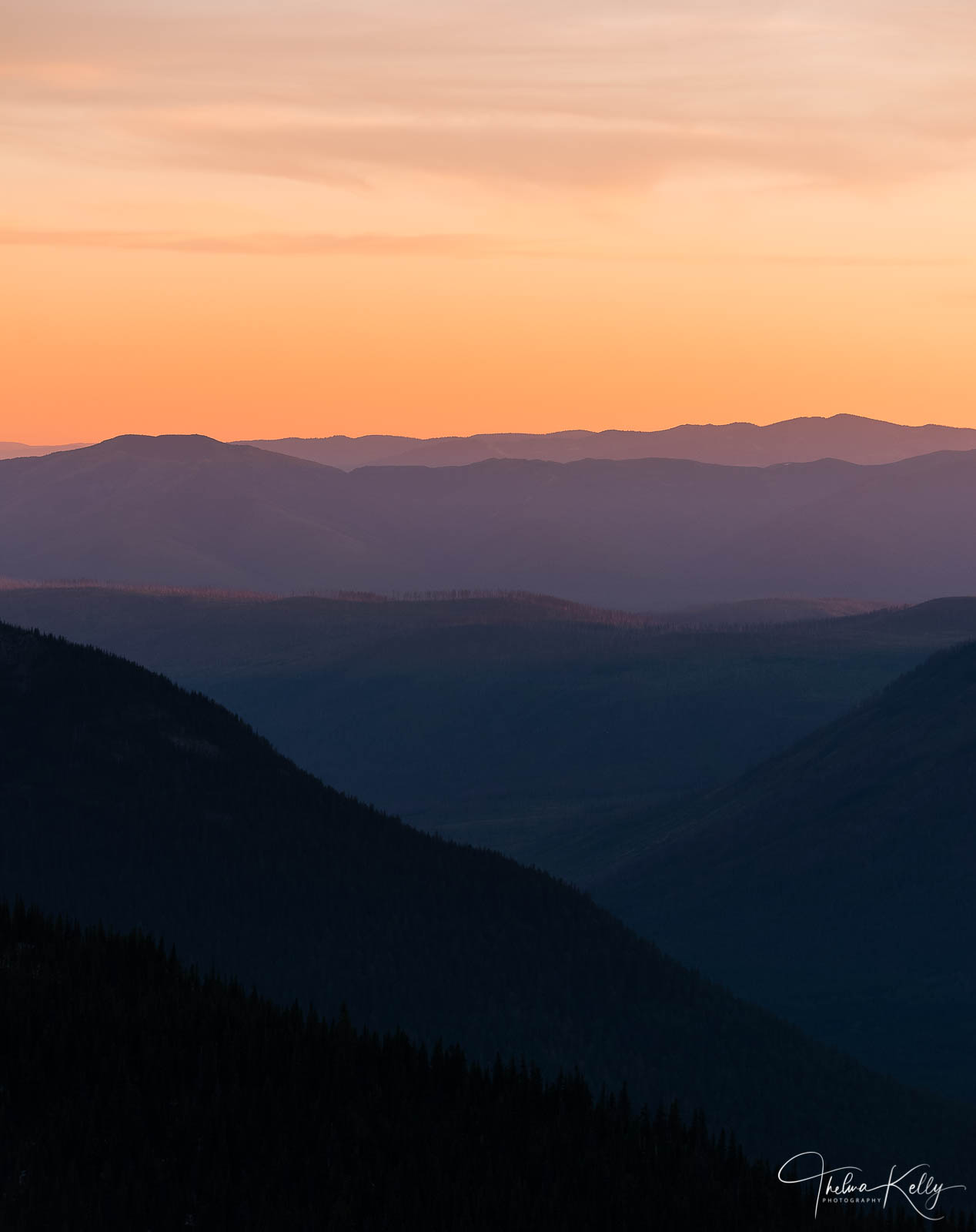 I stood there at sunset overlooking the mountains and taking photos every few seconds, as I watched the sky turn into pastel...