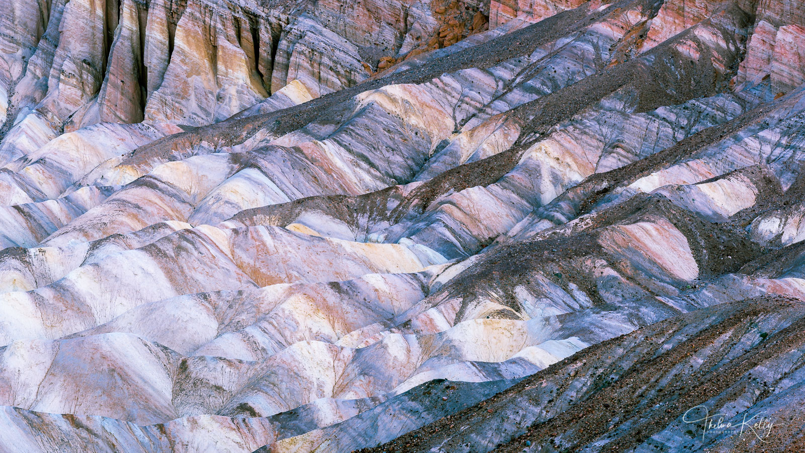 Death Valley National Park is so much more than sand. Here at Zabriskie Point, the colors, textures, lines and curves lends itself...