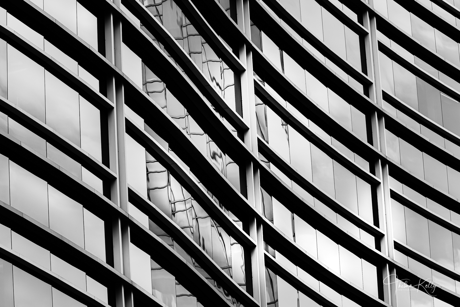 Undulating waves of perfectly molded glass and steel